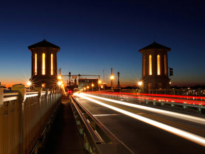 A slow shutter speed is used to captures vehicles crossing the Bridge of Lions, part of the A1A Scenic and Historic Coastal Byway, at dusk in St. Augustine. Daron Dean for VISIT FLORIDA