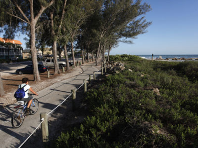 A cyclist rides along the Coquina Beach trail in Bradenton Beach on Anna Maria Island that overlooks the Gulf of Mexico. Bradenton Beach has more than five miles of bike paths and bike lanes along Gulf Drive, which includes 2.8 miles of the Bradenton Beach Scenic Highway. Biking Anna Maria Island May 5, 2013 Photo by Lara Cerri