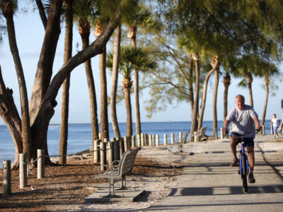 Bradenton Beach resident Paul Curtis takes his morning bicycle ride on one of the many bike trails on Anna Maria Island that are accessible from the Bradenton Beach Scenic Highway. (Bradenton Beach Scenic Highway on Anna Maria Island is a waterfront highway corridor that offers nature, scenery, and pedestrian and bike-friendly paths. At 2.8 miles long, it offers panoramic views of the Gulf of Mexico and Sarasota Bay along Highway 789. It also includes access to Leffis Key, an island preserve with trails and plenty of wildlife and bird viewing.) (Bradenton Beach Scenic Highway) Photo made on 11/30/15 Photo by Lara Cerri