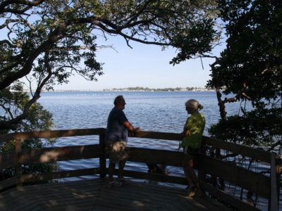 Al and Angela Crisp, of Holmes Beach, look out over Sarasota Bay from Leffis Key, an island preserve that is directly accessible from the Bradenton Beach Scenic Highway. (Bradenton Beach Scenic Highway on Anna Maria Island is a waterfront highway corridor that offers nature, scenery, and pedestrian and bike-friendly paths. At 2.8 miles long, it offers panoramic views of the Gulf of Mexico and Sarasota Bay along Highway 789. It also includes access to Leffis Key, an island preserve with trails and plenty of wildlife and bird viewing.) (Bradenton Beach Scenic Highway) Photo made on 11/30/15 Photo by Lara Cerri