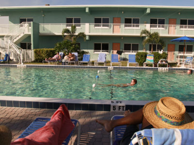 Visitors at the Via Roma Beach Resort relax in and around the pool on a November afternoon. The Mediterranean-style resort includes condos with kitchens, a beachfront pool and BBQ area. It is located at 2408 Gulf Dr. N., right on the Bradenton Beach Scenic Highway. (Bradenton Beach Scenic Highway on Anna Maria Island is a waterfront highway corridor that offers nature, scenery, and pedestrian and bike-friendly paths. At 2.8 miles long, it offers panoramic views of the Gulf of Mexico and Sarasota Bay along Highway 789. It also includes access to Leffis Key, an island preserve with trails and plenty of wildlife and bird viewing.) (Bradenton Beach Scenic Highway) Photo made on 11/30/15 Photo by Lara Cerri