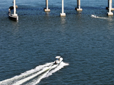 Tampa, Florida. 2/20/2016. Boats head toward and go under the causeway road and the scenic trail. Photos of the Courtney Campbell Scenic Highway and areas along it. Photo by Bill Serne