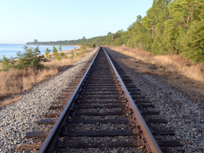 Railroad tracks hug the coastline at Bay Bluffs Park along Pensacola Scenic Bluffs Highway.