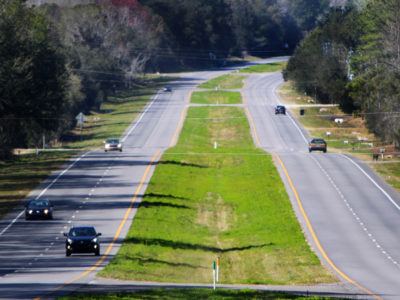 Cars travel along a section of the Old Florida Heritage Highway near Micanopy.