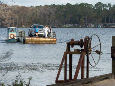 The ferry at Fort Gates Ferry brings cars across the St. Johns River on December 28, 2015. The dirt road that leads to the ferry is a spur road of the Florida Black Bear Scenic Byway. The landing has been the site of a ferry crossing for nearly 200 years. Photo by Tom Burton