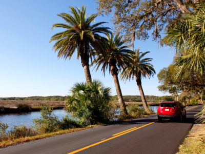 A car travels north on High Bridge Road, along Bulow Creek, in the southern portion of the Heritage Crossroads: Miles of History Heritage Highway. The Florida Scenic Highway, comprised of 89 miles of roadways, travels through Flagler, Volusia and St. Johns Counties in northeastern Florida. Daron Dean for VISIT FLORIDA