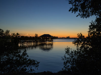 A peek through the trees at Riverside Park at dusk along the Melbourne Causeway in Indialantic. | Photos by: Willie J. Allen Jr.