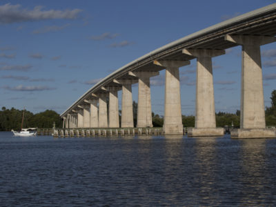 A sailboat crosses under the Wabasso Bridge along the Indian River at Wabasso Beach. | Photos by: Willie J. Allen Jr.