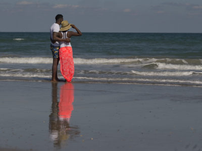 Terrance Thomas and Courtney Bass of Texas enjoy their view of the Atlantic Ocean from the sands of Cocoa Beach. | Photos by: Willie J. Allen Jr.