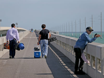 Overseas Highway- A couple of men head out for afternoon of fishing from a bridge north of Duck Key along the scenic Overseas Highway in the middle Florida Keys.