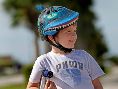 Overseas Highway- 5 year-old Jacob Reed wears his ocean themed head gear as he rides his scooter along the Keys Overseas Heritage Trail which is alongside the scenic Overseas Highway near