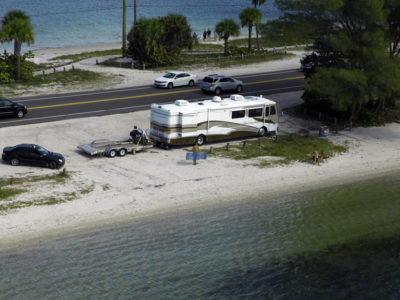 Bradenton Florida. 2/20/2016. A motorhome and family parked alongside the Palma Sola Scenic Highway at the east end. Photos of the Palma Sola Scenic Highway and areas along it. Photo by Bill Serne