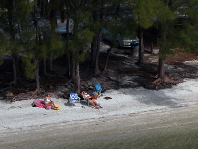 Bradenton Florida. 2/20/2016. A group of sunbathers enjoy the beach alongside the Palma Sola Scenic Highway at the east end. Photos of the Palma Sola Scenic Highway and areas along it. Photo by Bill Serne