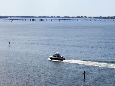 Bradenton Florida. 2/20/2016. A trawler heads up the channel from Tampa Bay that leads under the Palma Sola Scenic Highway. Photos of the Palma Sola Scenic Highway and areas along it. Photo by Bill Serne