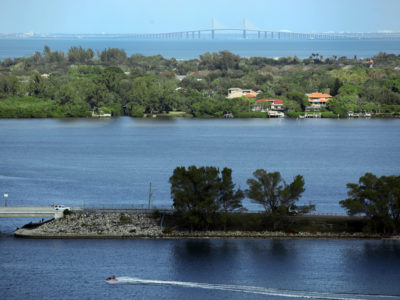 Bradenton Florida. 2/20/2016. Looking northeast with the Palma Sola Scenic Highway in the foreground, the Sunshine Skyway Bridge is in the background. Photos of the Palma Sola Scenic Highway and areas along it. Photo by Bill Serne