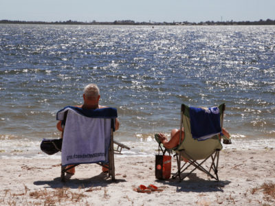 Bradenton Florida. 2/22/2016. A couple enjoys the sun, sand and water on the south side of the Palma Sola Scenic Highway near the west end of the causeway. On the ground photos of the Palma Sola Scenic Highway and areas along it. Photo by Bill Serne