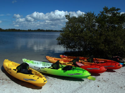 Bradenton Florida. 2/22/2016. Rental kayaks ready to head out to the Robinson Preserve at the Surfer Bus kayak concession at the west end of the Palma Sola Scenic Highway. On the ground photos of the Palma Sola Scenic Highway and areas along it. Photo by Bill Serne