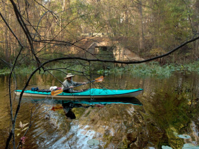 A paddler loads in his kayak into the Ockalawaha River on SR along the Florida Black Bear Scenic Byway on December 28, 2015. Photo by Tom Burton