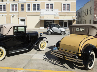 Two antique Fords are parked in front of O'Hara Restorations in Frostproof on the Ridge Scenic Highway. O'Hara's is known statewide for their vintage and custom car restoration and maintenance. WILLIE J. ALLEN JR.