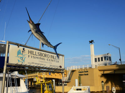 Broward County -- You can stop and see the fishing charter boats at Hillsboro Inlet Fishing Center just west of the Hillsboro Inlet Bridge -- the statue on top of the bridge, which was dedicated in 2016, is the famous Barefoot Mailman. Photo by Peter W. Cross