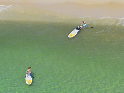 Broward County -- Paddle boarders head out on the Atlantic Ocean just yards from Scenic Highway A1A in Ft. Lauderdale. Photo by Peter W. Cross