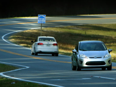 A car travels along the Scenic Sumter Heritage Byway near the Florida National Veterans Cemetery in Bushnell, Fla.