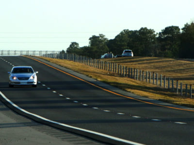 Cars travel along the Suncoast Scenic Parkway.