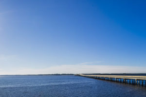 The sun sparkles on Ochlockonee Bay as the U.S. Highway 98 bridge carries drivers on the Coastal Trail of the Big Bend Scenic Byway. COLIN HACKLEY PHOTO