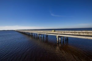 Blue sky and the blue water of Ochlockonee Bay as the U.S. Highway 98 bridge carries drivers on the Coastal Trail of the Big Bend Scenic Byway. COLIN HACKLEY PHOTO