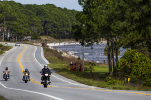 Motorcyclists travel the Coastal Trail portion of the Big Bend Scenic Byway a few miles west of on Carrabelle U.S. Highway 98. COLIN HACKLEY PHOTO
