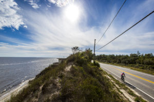 A bicyclist climbs a hill beside the Gulf of Mexico while riding the Coastal Trail portion of the Big Bend Scenic Byway west of on Carrabelle U.S. 98. COLIN HACKLEY PHOTO