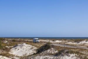An RV drives among the dunes drive on the Big Bend Scenic Byway in St. George Island State Park. COLIN HACKLEY PHOTO