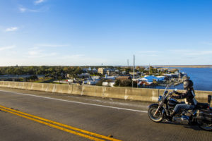 A motorcyclist rides the U.S. Highway 98 bridge over the Apalachicola River heading into Apalachicola. COLIN HACKLEY PHOTO