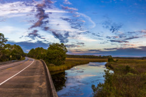 A panoramic view of Fla. Highway 65 north of Eastpoint at the Doyle Creek crossing as a full moon rises on the Big Bend Scenic Byway, Forest Trail West section. COLIN HACKLEY PHOTO EDITOR'S NOTE: This image is comprised of multiple photos taken at the same moment and stitched together by Photoshop to create a panorama.