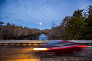 Fla. Highway 65 north of Eastpoint where it crosses Graham Creek as a full moon rises over the Forest Trail West section of the Big Bend Scenic Byway. COLIN HACKLEY PHOTO