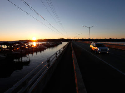 The sun rises as vehicles travel across the Julington Creek Bridge, the northern most part of the 17-mile William Bartram Scenic and Historic Highway, in western St. Johns County. Daron Dean for VISIT FLORIDA