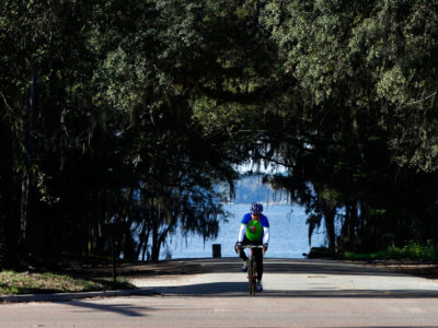 A bicyclist prepares to turn back on to the William Bartram Scenic and Historic Highway after a stop at the St. Johns River. Daron Dean for VISIT FLORIDA