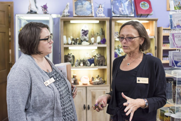 Kelly Frasca, event planner for City of Lake Helen, chats with Dawn, who organizes Cassadaga events. — at Cassadaga Spiritualist Camp.
