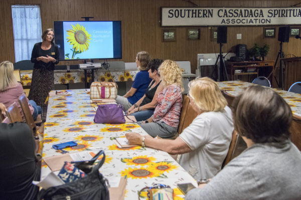 Orientation and history before the tour — at Cassadaga Spiritualist Camp.
